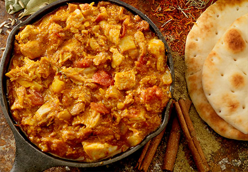 Heaton Balti Stockport richly flavoured chicken curry served with naan