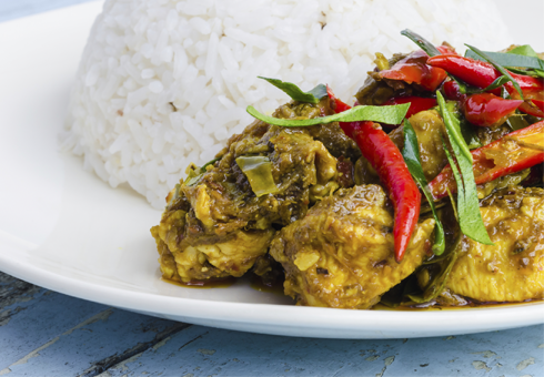 Freshly cooked Chicken curry dish with rice and chillis. Spice Trail, Magor