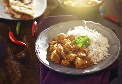 Hilton Swansea chicken curry dish with a side of rice and a naan
