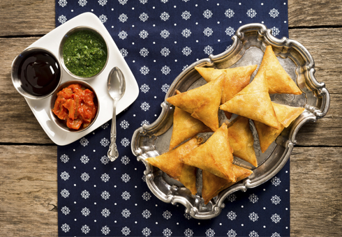 Freshly prepared samosas. The Spice, London.