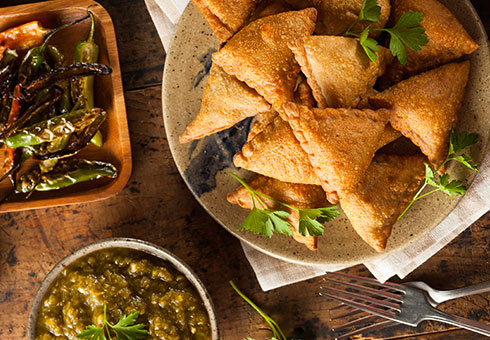 Village Spice Frome crispy vegetable samosas with traditional accompaniments