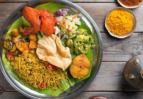 Rannaghor London tandoori chicken wing with spicy rice