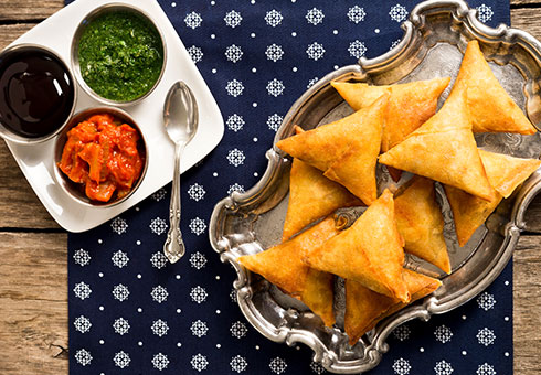 Rannaghor London crispy vegetable samosas with authentic indian accompaniments